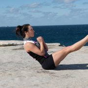 Vanessa Bartlett doing a signature Pilates exercise - The Teaser for Core Strength and Body Balance